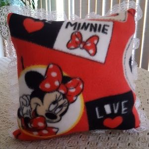 Minnie Mouse Pillow and two other items.